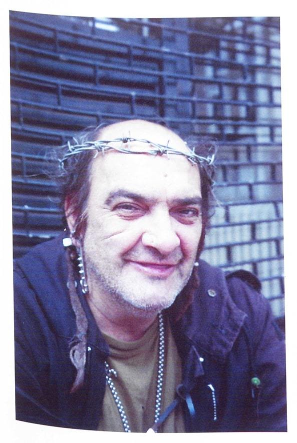 balding man wearing barbed wire crown
