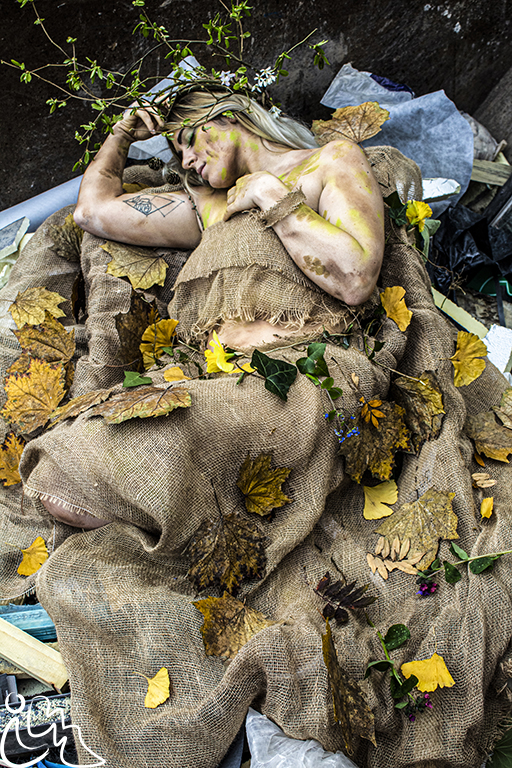 Photo of human figure lying down in leaves