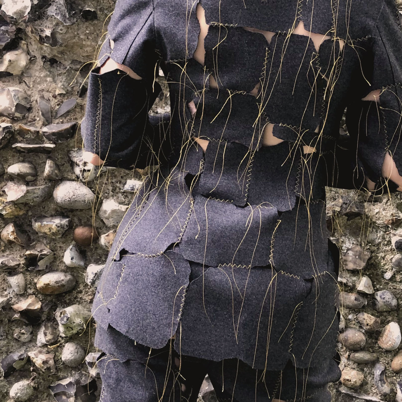 Photograph of the back view of model in suit