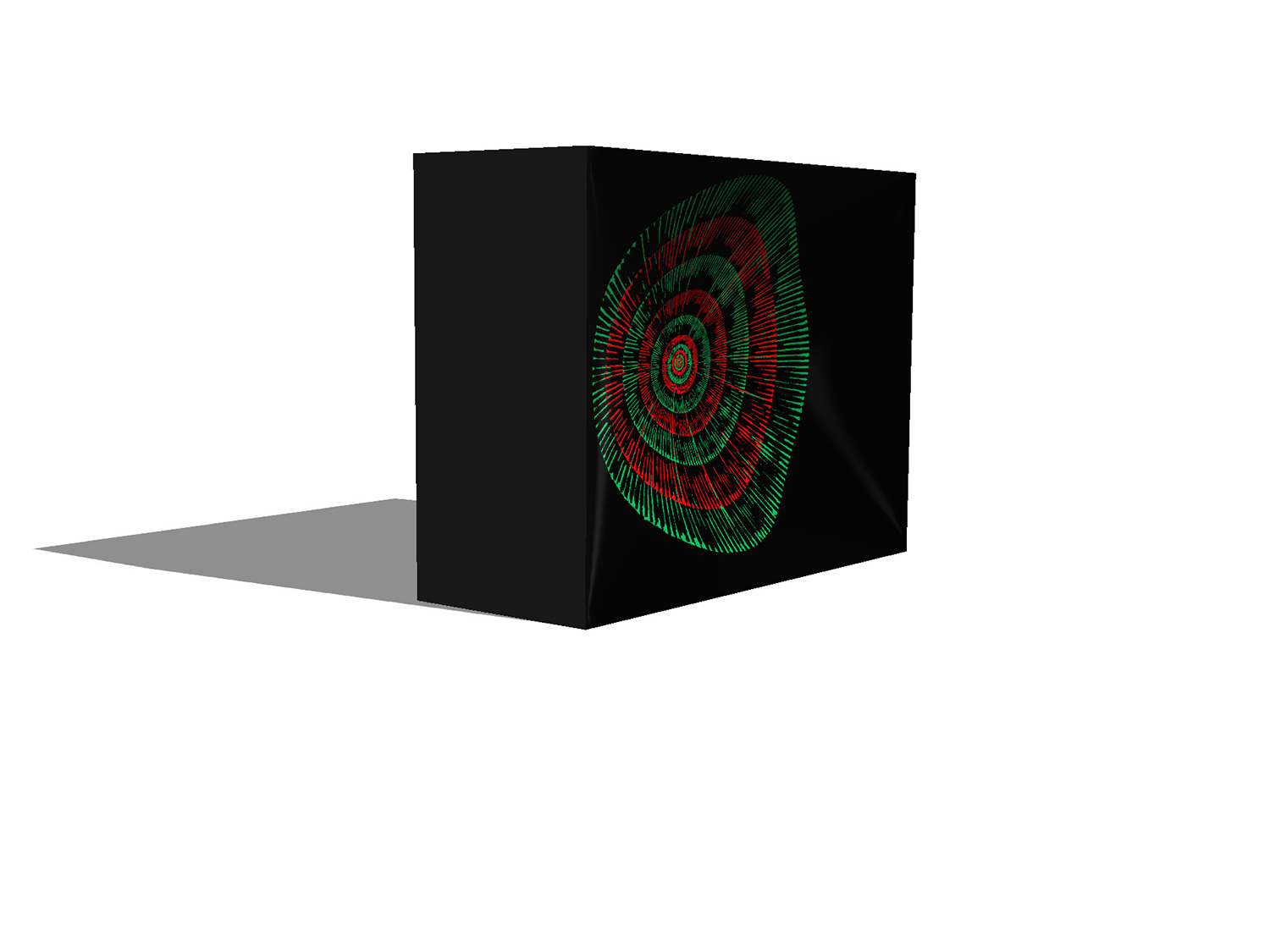 Simulation of a black block with a concave indent inlaid with concentric circles of colour, green and red