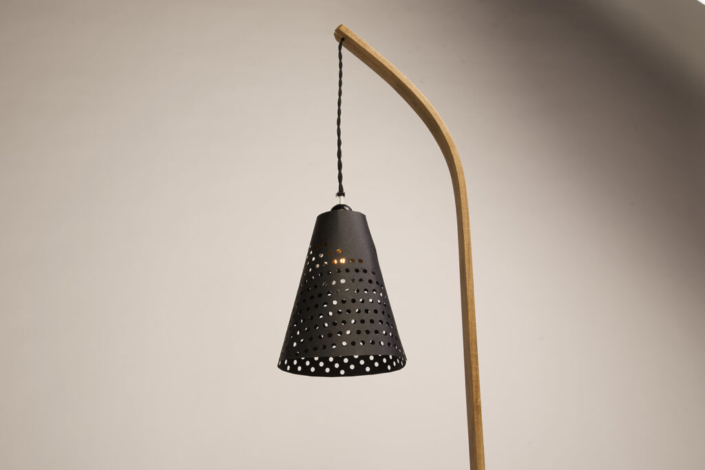 Lamp with wooden base and veneer shade.