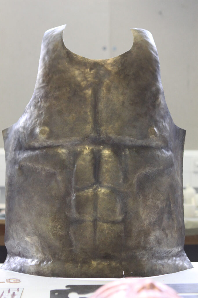 Armour sculpted to look like a male chest.